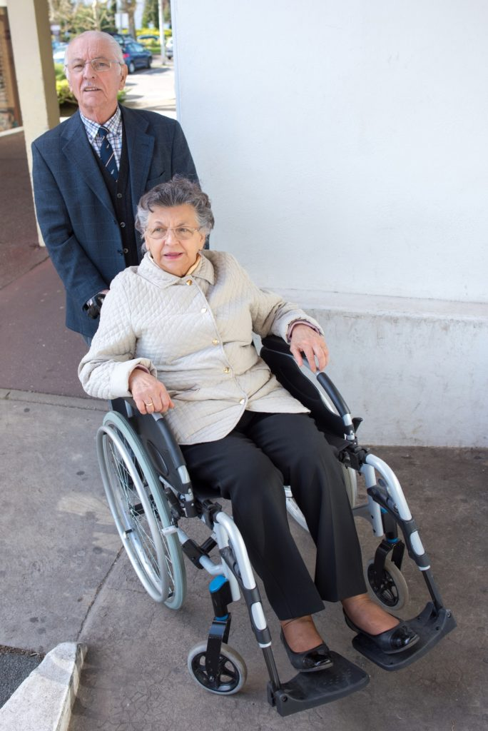 elderly couple in street